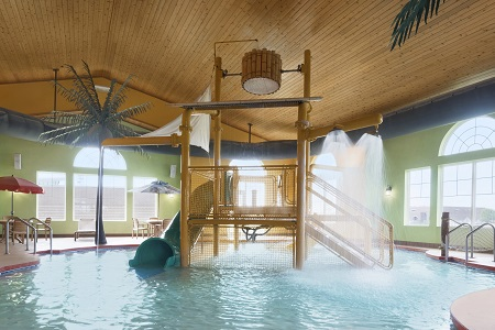 Indoor pool with jungle gym and slide