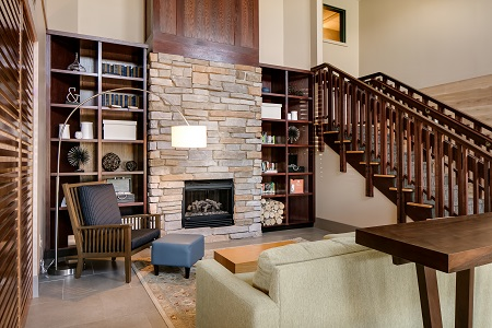 Madison hotel lobby with a stone fireplace and comfortable seating