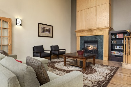Welcoming lobby with a fireplace, a library and comfortable seating