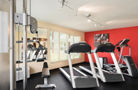 Red accent wall in our Monona hotel's fitness center