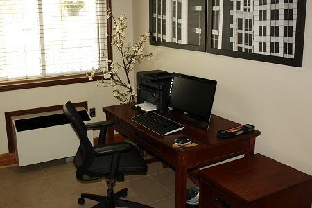 Business centre with computer and printer on dark wood desk