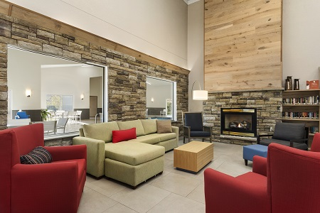 Inviting lobby with a fireplace and a library at this hotel in Platteville
