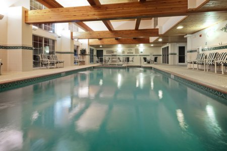 Indoor pool with wooden beams overhead