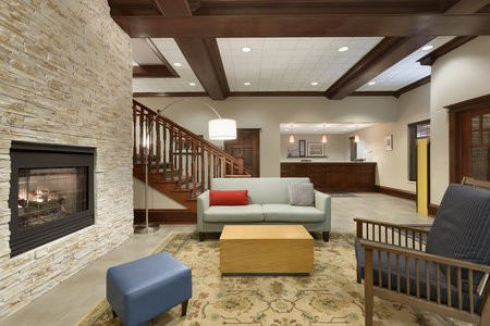 Hotel's modern lobby in Wausau with stone fireplace