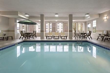 Indoor pool surrounded by deck chairs