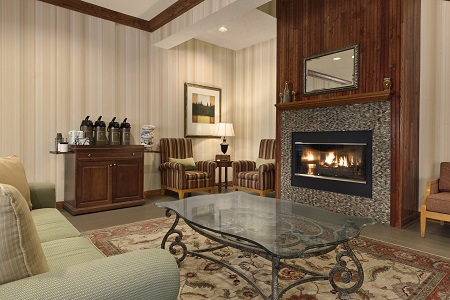 Coffee station and fireplace in hotel lobby