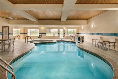 Indoor pool and hot tub at hotel in West Bend