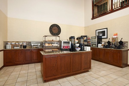 Hotel breakfast area with a spread of bagels and coffee