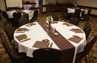 Round table setting in Beckley hotel's meeting space
