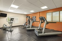 Fitness center with cardio equipment and multi-gym