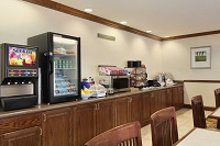 Breakfast area with juice dispenser and fridge for cold items