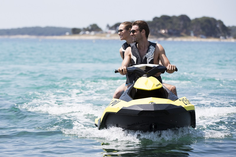 Couple riding a watercraft across the Adriatic Sea