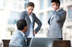 People holding discussion in business clothes