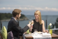 Couple toasting each other at seaside restaurant in Pula