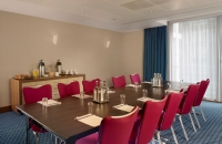 Meeting room with long rectangular table and window