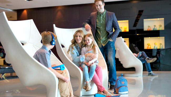 Family Sitting On Or Standing Around Contemporary Lobby Furniture