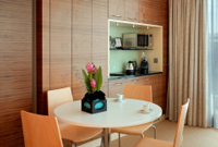 Dining area with round table and kitchenette