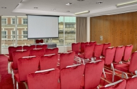 More than two dozen chairs in Leeds conference room