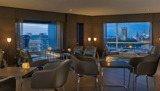 Executive Lounge with comfortable chairs and views of London
