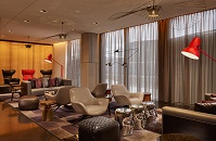 Hotel lounge with chic decor and floor-to-ceiling windows
