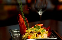 Tray with lobster, grains and vegetables