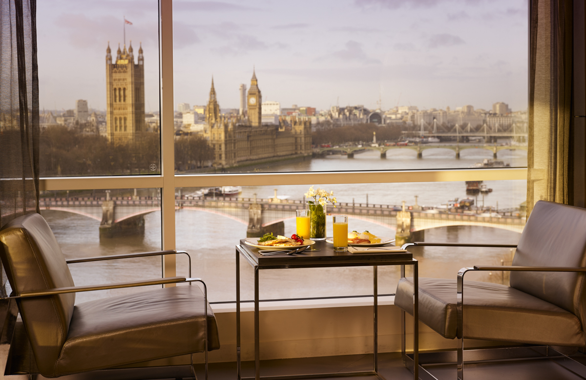 Table set with food overlooking the Thames