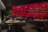 Restaurant with vibrant red wall on London's riverbank