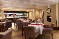 London hotel meeting arrangements with tables and chairs