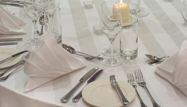 White linens in place setting at Victoria London banquet