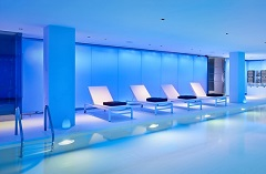 Indoor pool with dramatic blue lighting