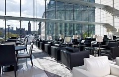 Black leather chairs and wall of windows in Executive Lounge