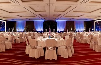 Round tables decorated in white and silver for wedding