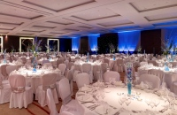 Round tables decorated in white, silver and blue for banquet