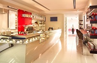 White and red coffee bar with seating along one side