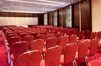 Rows of red chairs in meeting room