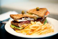 Gourmet sandwich and fries at a Park Plaza restaurant