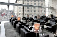 Rows of black leather chairs near windows