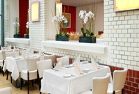 Berlin city-centre restaurant with fresh white table linens