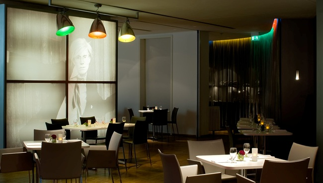 Berlin hotel's seating area with wall art of Andy Warhol