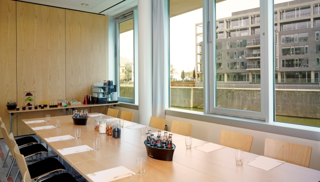 Meeting room with board room setup and cityscape views
