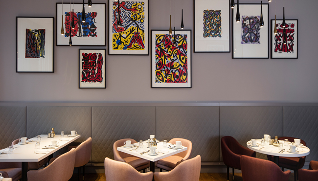 Colourful Baselitz Works Hanging In Breakfast Room