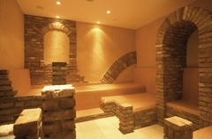 Stone and tile spa facility with Roman decor