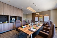 Boardroom with audiovisual equipment and complimentary water