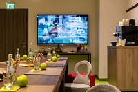 Trier event space with a beverage station and a flat-screen TV