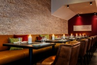 Candlelit booths at Restaurant Plaza Grill & Lounge in Trier