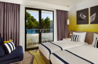 Pula hotel room featuring navy, white and yellow decor