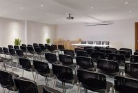 Medulin meeting space with chairs arranged for event