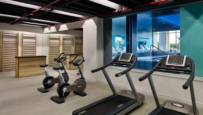 Medulin resort's fitness centre with two bikes and treadmills