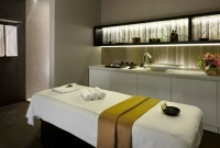White massage table with towel at hotel spa in Pula