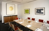 Meeting room with long table and modern artwork